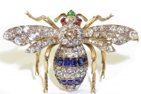Diamond, emerald, ruby and sapphire brooch in the form of a bug, with a coloured diamond to the body. English. Circa 1880. Courtesy BADA 2017 © Sandra Cronan.