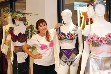 Nina Barough CBE with mannequins wearing designer bras from the Walk the Walk collection.