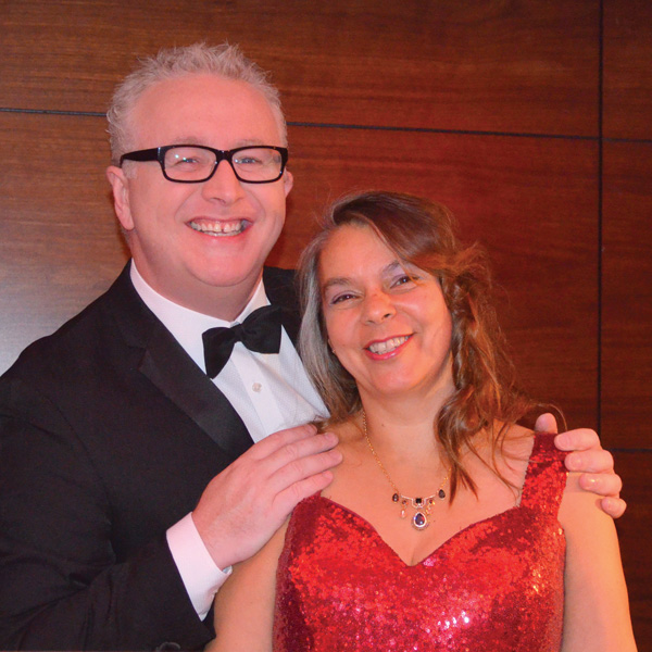 Greg Scott, Host of the evening and an ITV presenter, wth Julie Maclean, an entainer.